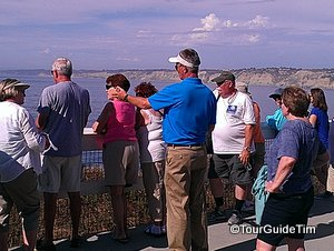 Guests listening to tour guide while looking out at La Jolla Cove