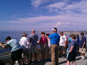 Tour Guide and Guests looking over La Jolla Cove