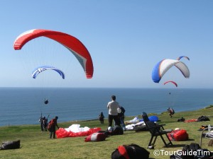 paragliders launching off cliffs at Torrey Pines