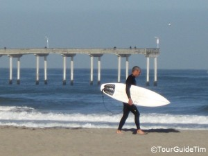 Surfer in Ocean Beach with the Pier in the background